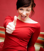 girl holding up thumb and winking