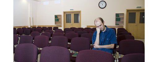 sleeping audience member in empty room