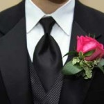 Best man with rose as button hole