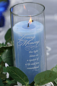 A candle with a poem on the side