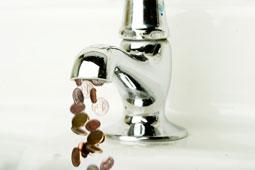loose change coming out of a tap