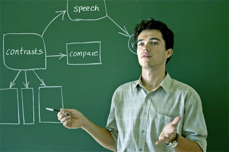 Man presenting at a chalk board saying compare and contrast