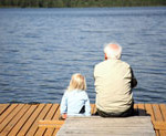 grandpa-and child by water