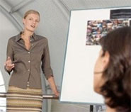 photo of a lady giving a presentation