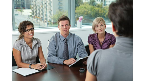 girl stood in front of interview panel