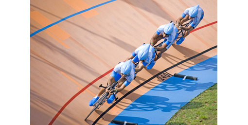 4 cyclists on a speed track
