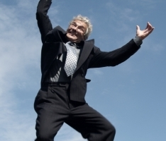 image of retiring man jumping up in the air in glee