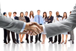group of sales people with handshake in front of them