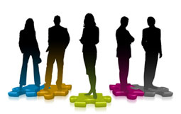 business people stood on jigsaw pieces