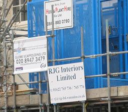 Signs attached to scaffoldilng