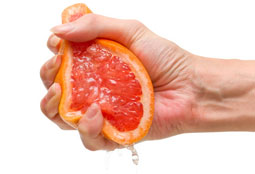 orange being squeezed